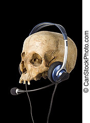 dead line - out of service - Human Skull with headphones and...