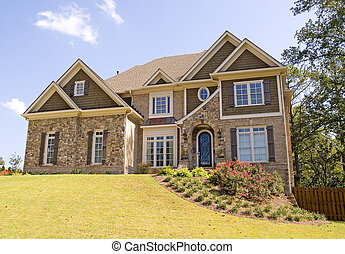 Nice House on Landscaped Hill - A nice stone and brick house...
