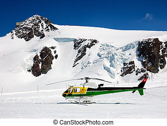 heli-ski helicopter - Rescue and heli-ski helicopter parked...