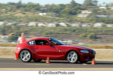 BMW Z4 Coupe - red german sports car competing in autocross