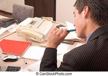 Businessman at office - Businessman in his office at table...