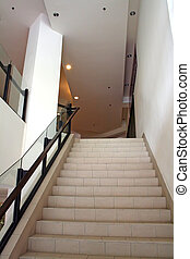 Modern staircase - Modern glass and steel staircase bright...
