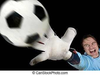 Goalkeeper defends ball