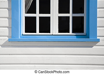 home sweet home: blue window against a white wall