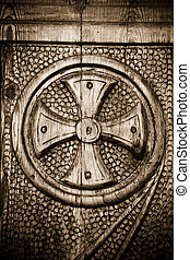 Religion and spirituality: cross on a Church door