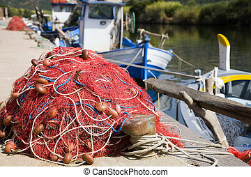 fishing nets - commerce and industry: red fishing nets and...