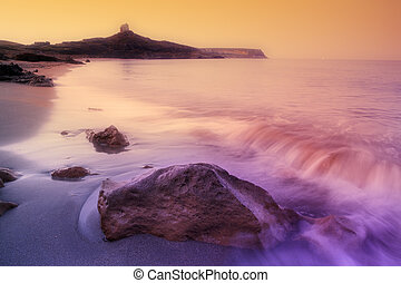 rocky shore - sunrise on a rocky shore in Sardinia, Italy