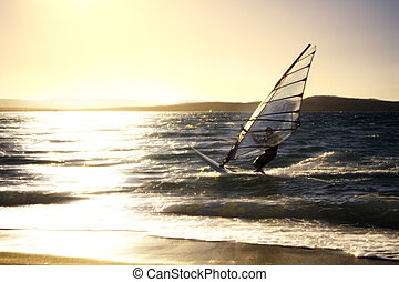 windsurfer - summer sports: windsurfer speeding fast against...