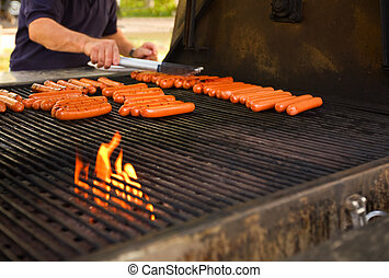 Barbecue cookout - Hot-dogs on a large barbecue...