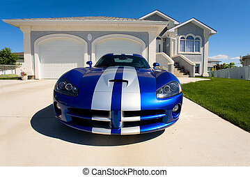 Home - luxury home with a sports car in the drive way