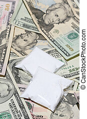 Illegal drug bust - Packets of drugs on top of US currency