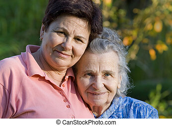 women - elderly woman and her daughter