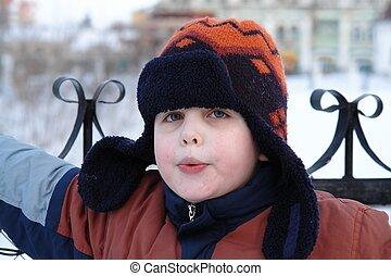 The little boy in a winter cap
