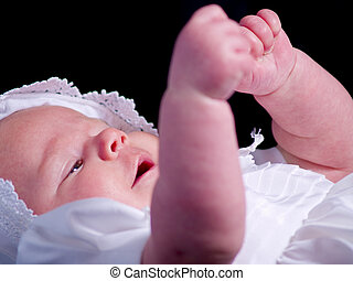 Baby Sign Language - A portrait of a baby girl in a...