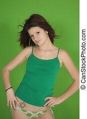 Tiffany - Young woman posing in front of a green background...