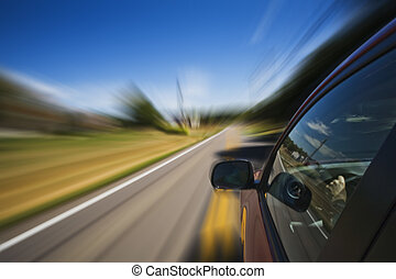 Automobile driving down road with a blured affect