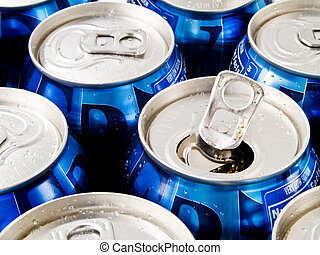 Refreshments - A close up on a bunch of soda cans. One of...