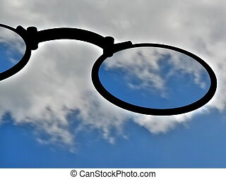 Blurry vision - Big glasses over blue sky with moving clouds