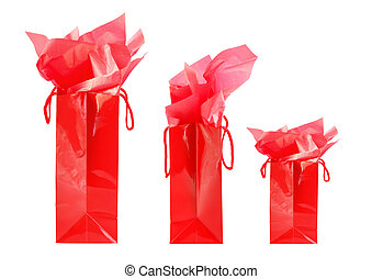 Red shopping bags - Three red shopping bags isolated on...