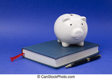 book and Piggy Bank, concept of education fund, tuition