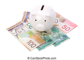 Piggy Bank and canadian dollars close up shot