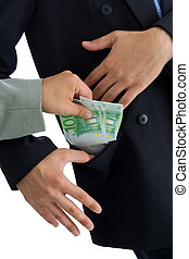 Bribe - Hands putting bribe into a pocket. The receiver...