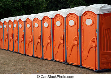 Row Of Portable Toilets - A row of portable orange toilets...