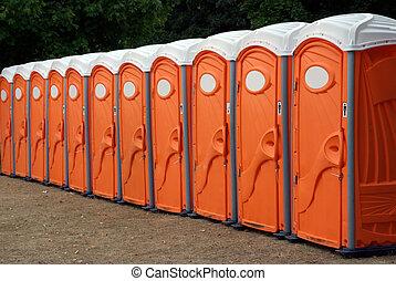 Row Of Portable Toilets - A row of portable orange toilets...