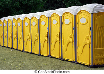 Row Of Red Portable Toile - A row of portable yellow toilets...