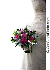 Wedding bouquet from roses on a background of a dress
