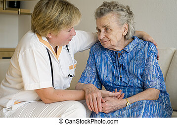 by a doctor - An elderly women being examined by a doctor