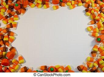 candy corn frames an open sign
