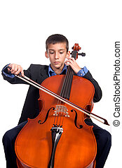 Boy playing Cello - Young boy student practicing playing...