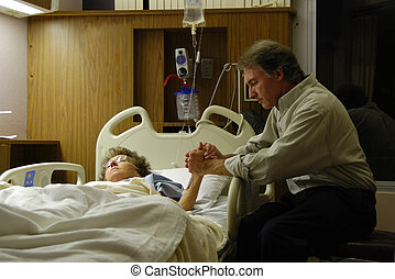 Praying in Hospital - Holding the hand of a sick loved one...