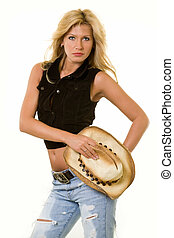 Cowgirl attire - Beautiful blond woman holding straw cowboy...