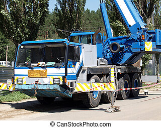 Crane truck - Mobile crane at work by the side of the road