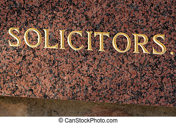 Solicitors - Sign carved in marble at up-market law practice