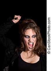 Scary creature - Woman with mad look in her face and big...