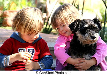 Friends forever - portrait of two children and their dog,...