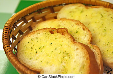 Garlic bread in a basket in restaurant setting