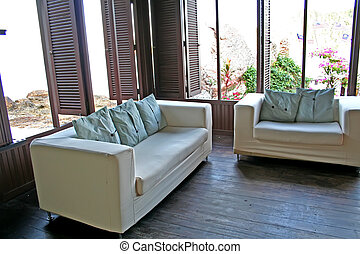 Seaside sofa - White fabric sofa with a view of the seaside