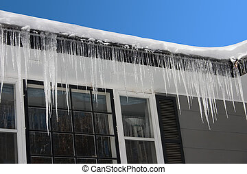 Icicles - icicles hanging from a rooftop