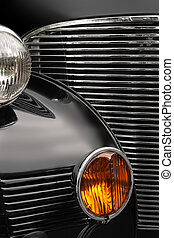 Antique car grill - The chrome grill and headlights of an...