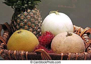 Tropical fruits - Basket of assorted tropical fruits...