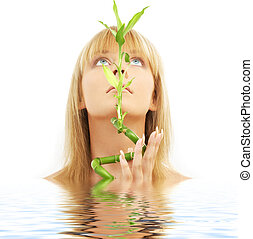 lovely blond with bamboo in water - bright picture of lovely...