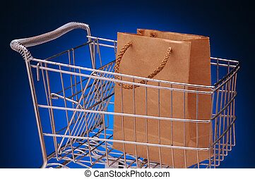 Grocery cart and bag - Grocery cart with empty brown paper...
