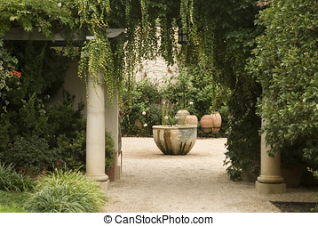 garden courtyard with columns,large pots and lots of...