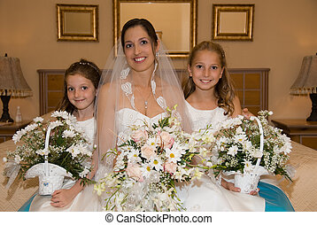 Bride and daughters - a lovely bride on her wedding day