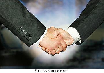 Best handshake - Business handshake over abstract blue...