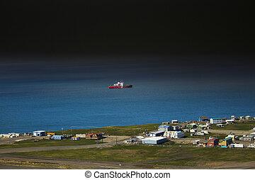 Icebreaker over town - Aerial photos of icebreaker near...